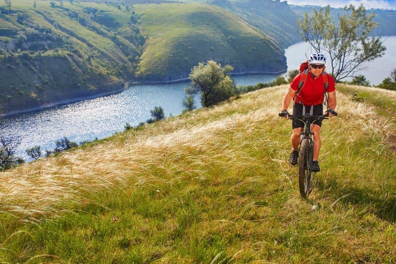 Adventure mountain biking on riverside royalty free stock image