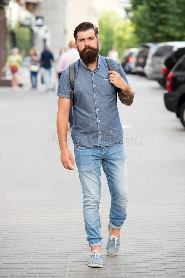 Adventure is out there. Mature hipster with beard. Bearded man. Confident brutal man walk street. Male hair barber care. Brutal caucasian hipster with stock image