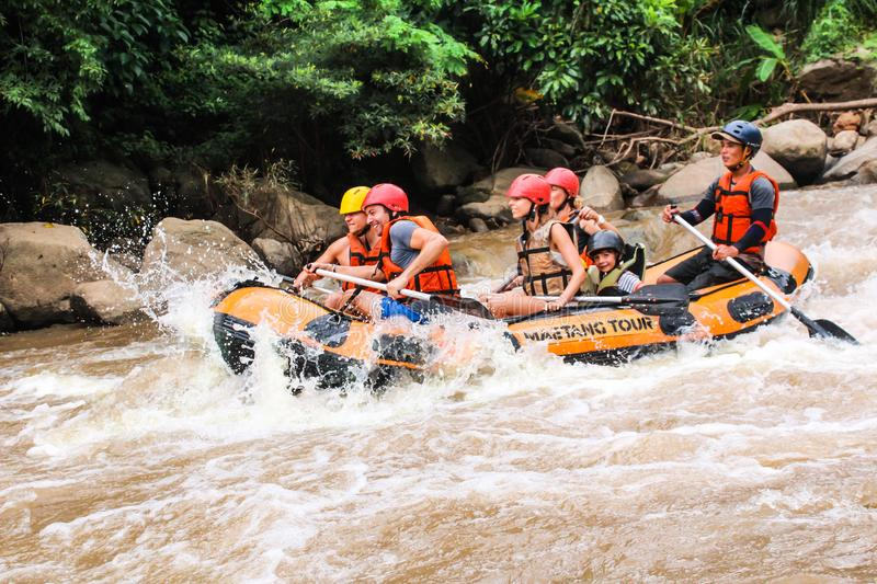 Mae Taeng,Chiang Mai/Thailand - August 3 Male and female tourists rafting at kued rive August 3,2017 Chiang Mai, Thailand stock photography