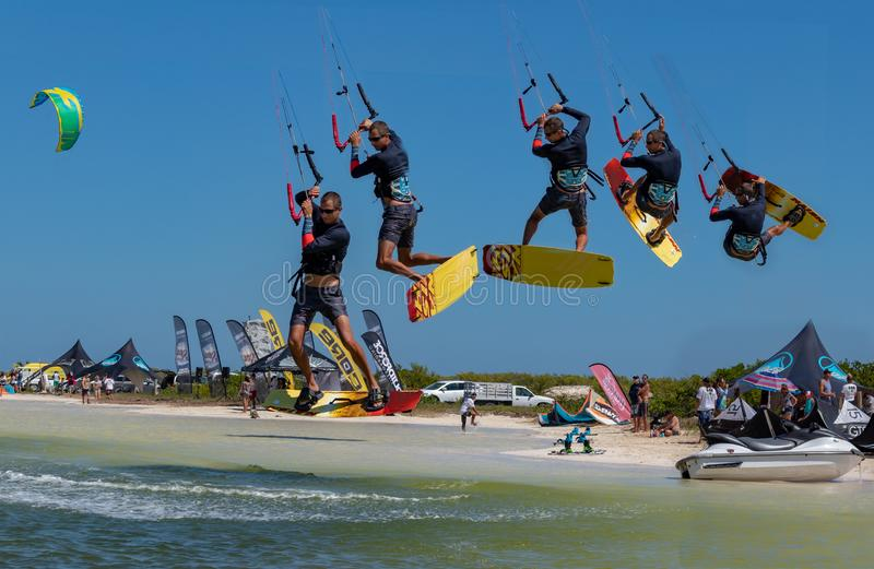 CANCUN, MEXICO - 02/18/2018: Adrenalin Kitesurf. Adventure sports Competition, Freestyle jumping at Mexican Caribbean. Adrenalin kitesurf on a sunny day stock image