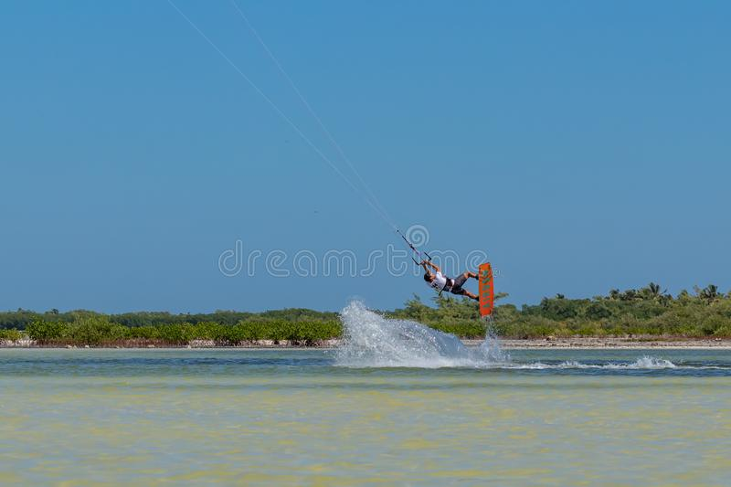 CANCUN, MEXICO - 02/18/2018: Adrenalin Kitesurf. Adventure sports Competition, Freestyle jumping at Mexican Caribbean. Adrenalin kitesurf on a sunny day royalty free stock photo