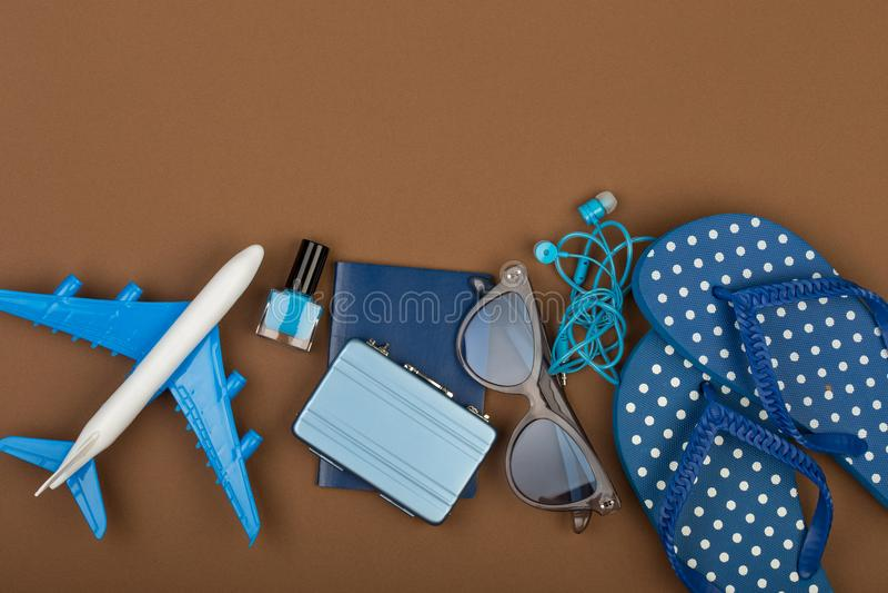 Adventure time - plane, flip flops, passport, little suitcase, sunglasses, nail polish stock photos