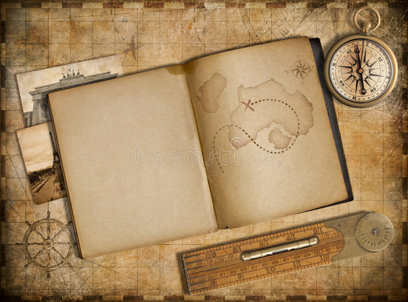 Adventure and travel concept. Vintage map, copybook and compass. Vintage map, copybook and compass stock illustration