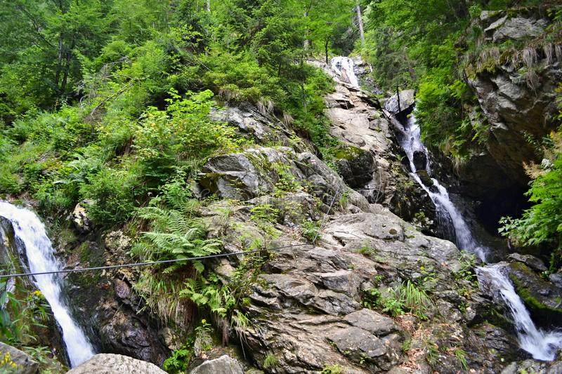 Adventure via ferrata hiking trail secured by steel ropes down up a stream stock images