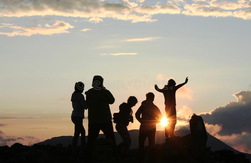 Adventurers at the summit. This photo was made of a little group on a summit in Kelemen mountains stock photos