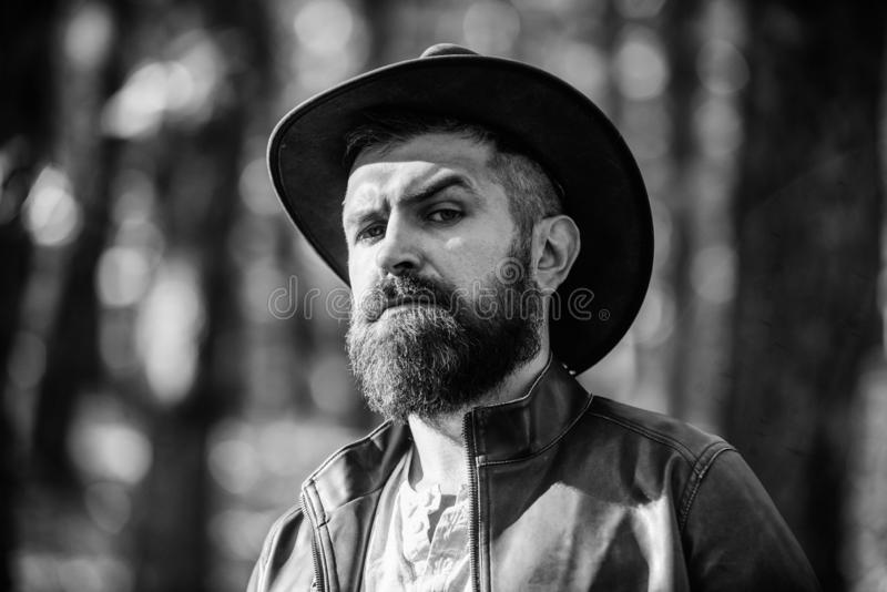 Adventures of cowboy. Man bearded cowboy nature background defocused. Brutal cowboy with long beard. Hipster tourist. Adventures of cowboy. Man bearded cowboy stock photos