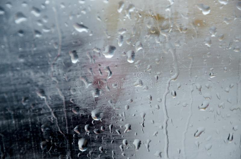 Adverse driving conditions. Dangerous driving during the heavy rain.View through car windshield stock photography