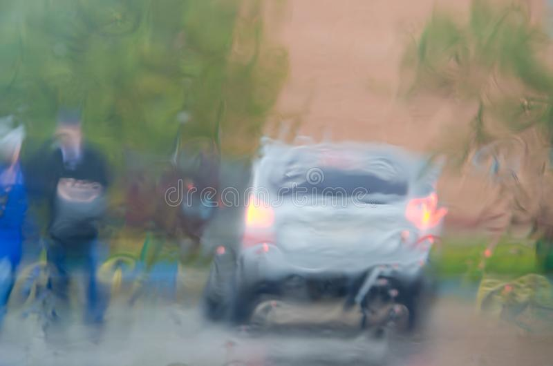 Adverse driving conditions. Dangerous driving during the heavy rain.View through car windshield stock photo