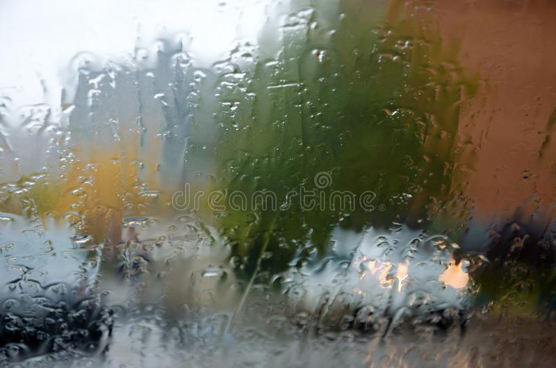 Adverse driving conditions. Dangerous driving during the heavy rain.View through car windshield stock images
