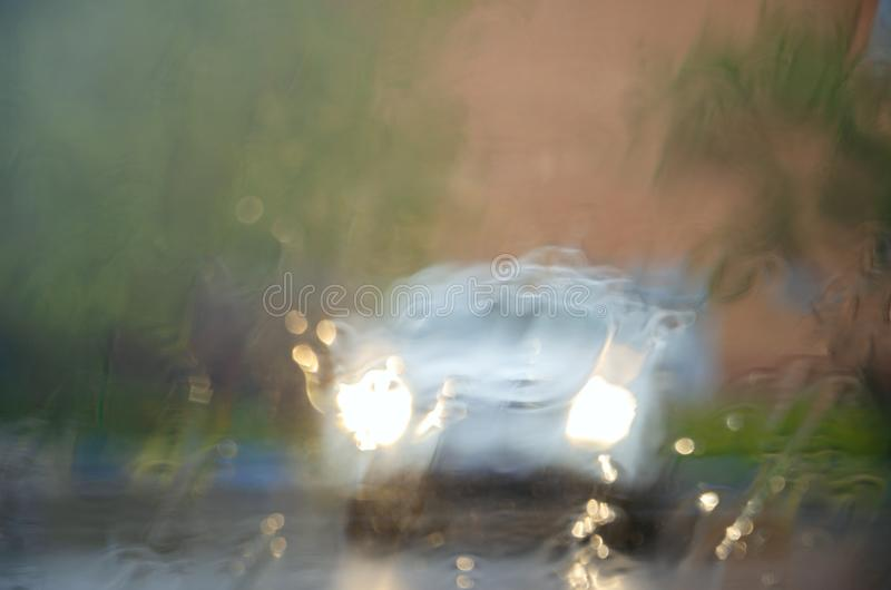 Adverse driving conditions. Dangerous driving during the heavy rain.View through car windshield royalty free stock photo