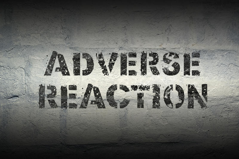 Adverse reaction gr. Adverse reaction stencil print on the grunge white brick wall royalty free stock image