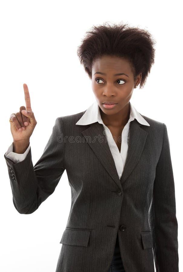 Advertencia: Mujer africana en el traje de negocios que aumenta el finger aislado imágenes de archivo libres de regalías