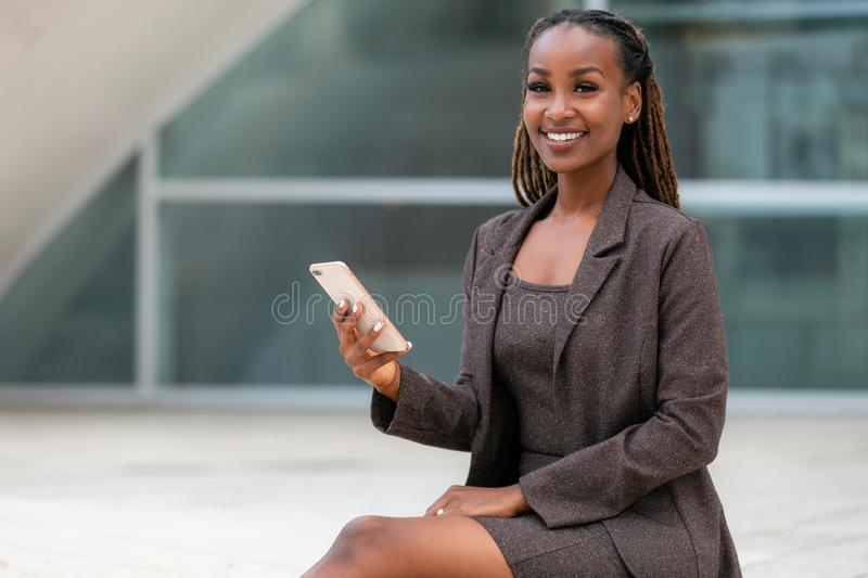 Advertisement commercial portrait for telecommunications, broadband, data, internet, smartphone, african american professional wom stock image