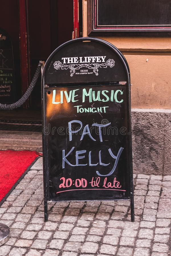 Advertisement for live music outside one Irish Pub stock photo
