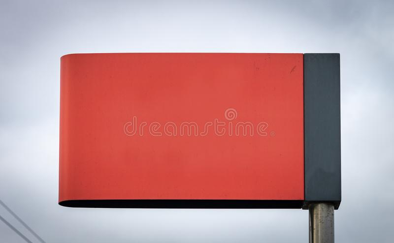 Advertisement Mockup Street Sign - Light Red. Light Red Street Sign Advertisement Mockup. Copy Space. Iron Pole. Cloudy Background royalty free stock image