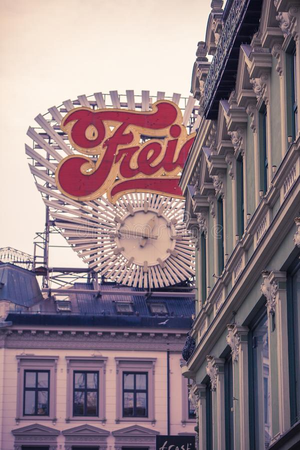 Advertisement sign roof round downtown oslo clock royalty free stock images