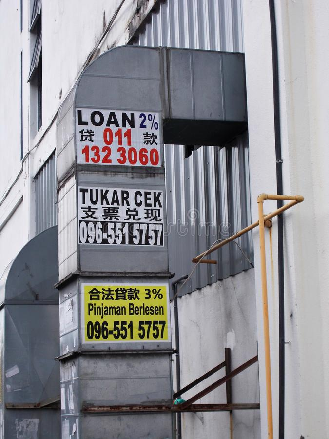 Advertisements By Illegal Money Lenders. Illegal advertisements - in the Malay, Chinese and English language - by illegal non-licensed money lenders on an air royalty free stock photo