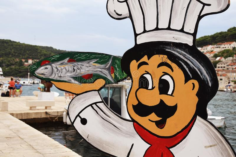 Advertising Banner - Cook with fish - Pučišća stock photography