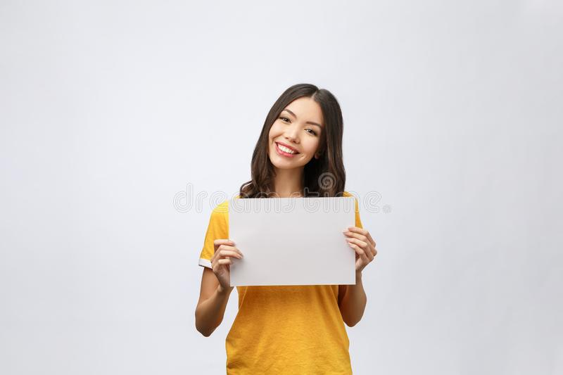 Advertising banner sign - woman excited pointing looking empty blank billboard paper sign board. Young business woman stock photos