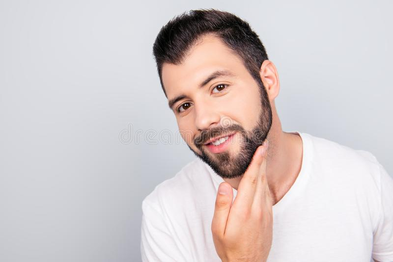 Advertising and barber shop, beard cut and styling concept. Close up portrait of a happy guy, who got his trendy fashionable cut royalty free stock image