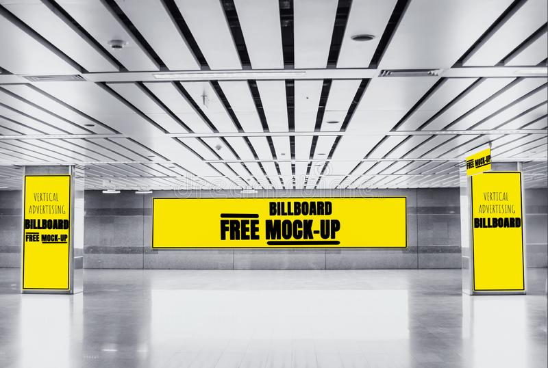 Advertising Billboard mockup panoramic and vertical,yellow light box showcase in subway,display empty space for text design royalty free stock photography