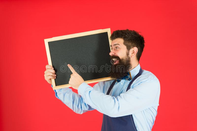 Advertising concept. great cuisine. cooking by recipe. welcome. Restaurant or cafe advertising. bearded hipster cook in. Apron. happy man chef with blackboard royalty free stock images
