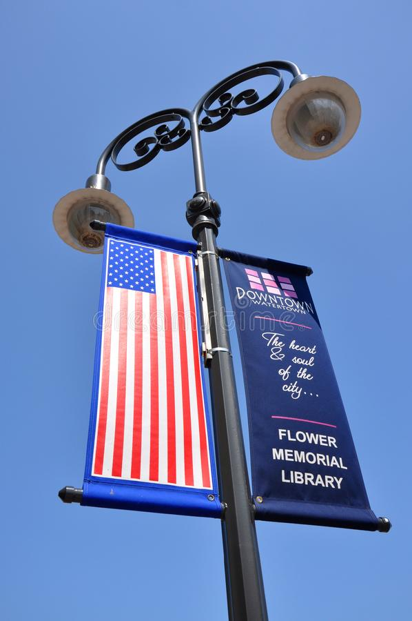 Advertising Flag in Watertown, NY, USA. Advertising Flag in Public Square in downtown Watertown, Upstate New York, USA royalty free stock photo