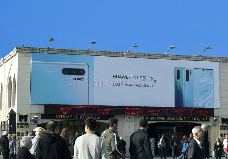 Advertising sign on the pier building at Kadikoy beach. Huawei p30 pro advertising signage appears. Istanbul, Turkey - November-07.2019: Advertising sign on the royalty free stock photos