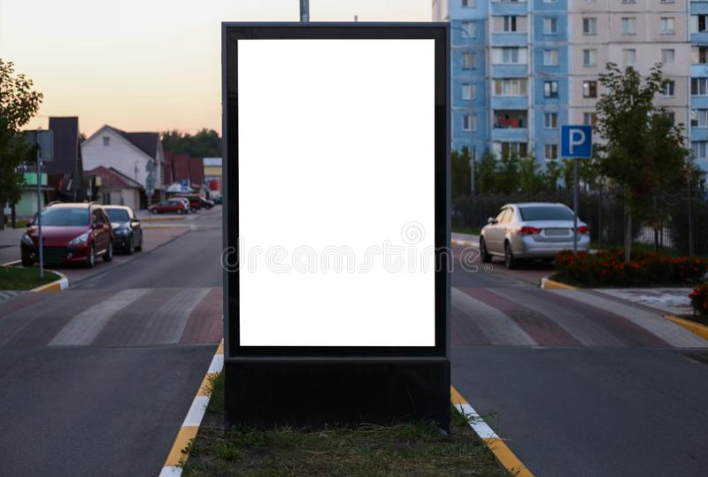 Advertising space under the poster. Lightposter citylight mockup small billboard in the city near the roadway. white space for stock photography