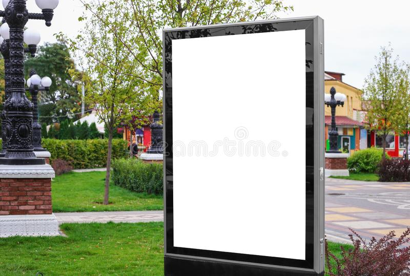 Advertising space under the poster. Lightposter citylight mockup small billboard in the city near the roadway. white space for stock images