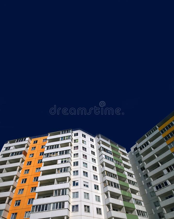 Free Advertising Template Of Apartment Sale And Rental Property. New Multicolor Residential Building On Dark Blue Background. Copy Stock Photography - 214107522
