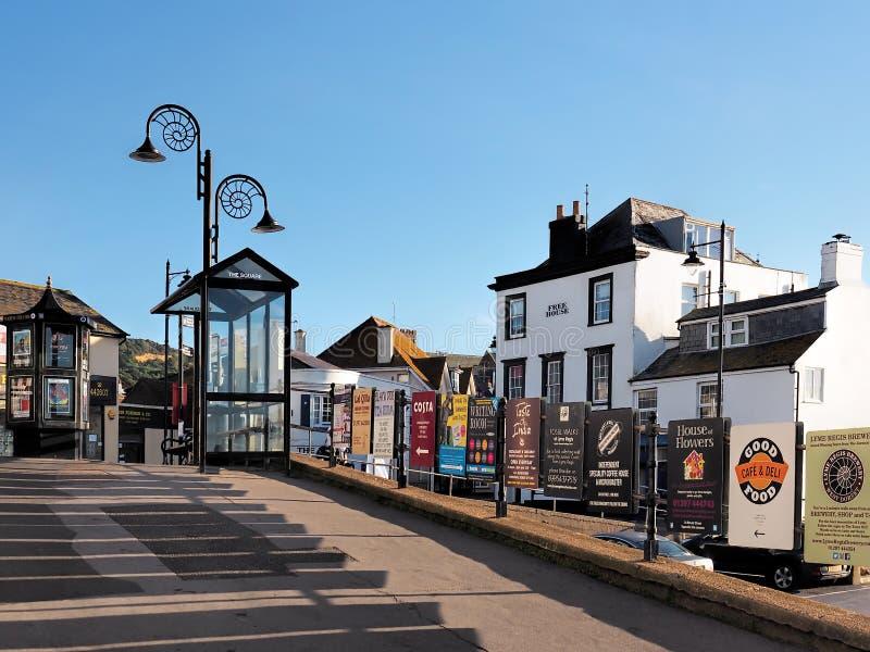 Advertizingtecken på Lyme Regis, Dorset arkivfoto