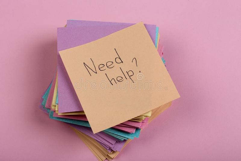 "Advice concept - Sticker with the words ""need help"" on pink background. Concept of asking for help stock photos"