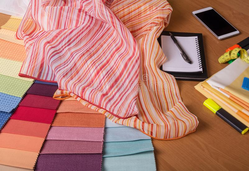 Advice about fabric choice and calculation of costs. Fabric store. Advice about fabric choice and calculation of costs. The fabric store stock images