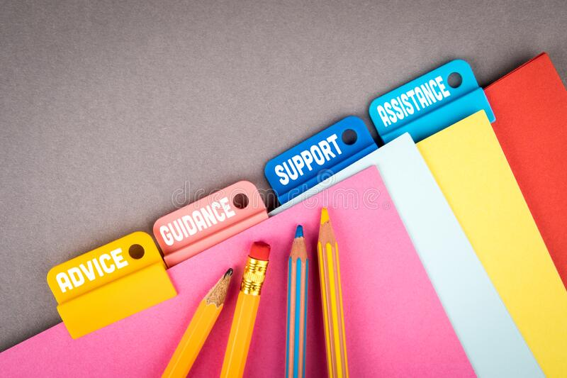 ADVICE, GUIDANCE, SUPPORT and ASSISTANCE concept. Folder Register of Card Index. Colored pencils stock photo