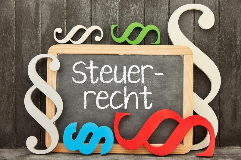 Advice from a specialist lawyer for tax law. German word Steuerrecht tax law as concept on a blackboard stock image