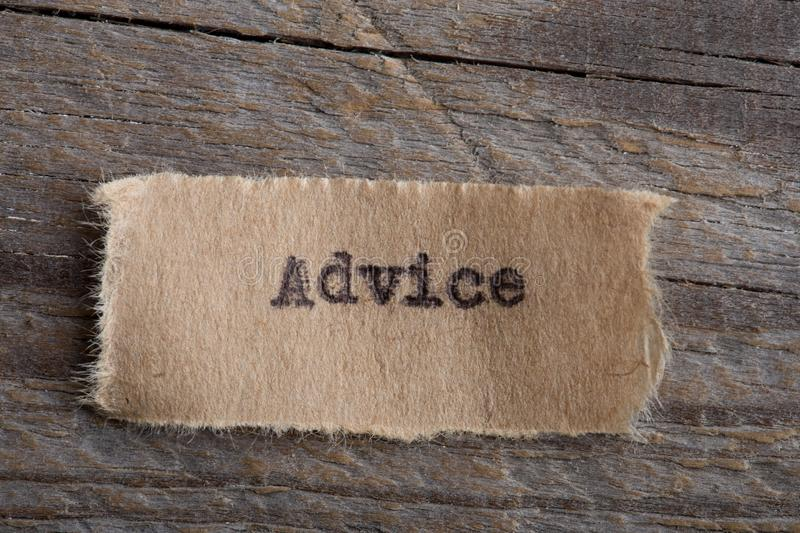 Advice word on a piece of paper close up, business creative motivation concept. Advice- word on a piece of paper close up, business creative motivation concept stock images