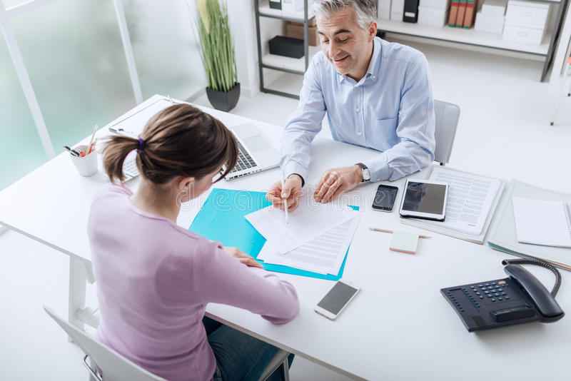 Advisor meeting with a customer stock image