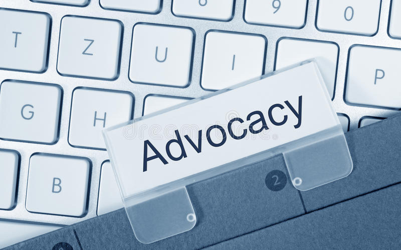 Advocacy folder on computer keyboard. In the office stock photos
