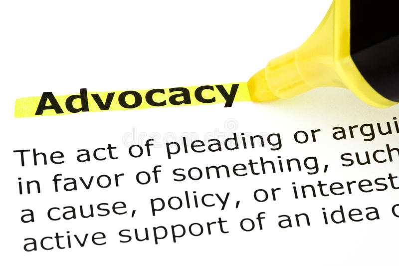 Advocacy highlighted in yellow. Definition of Advocacy highlighted with yellow felt tip pen royalty free stock image