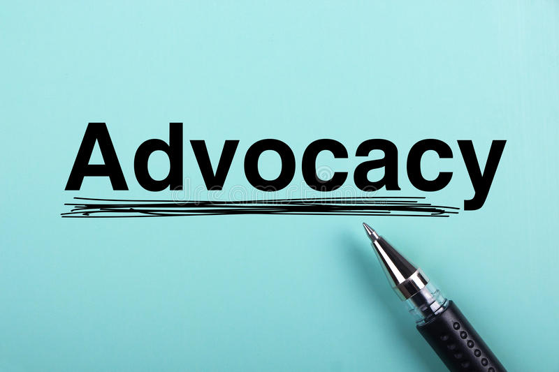 Advocacy. Text is on blue paper with black ball-point pen aside royalty free stock photo