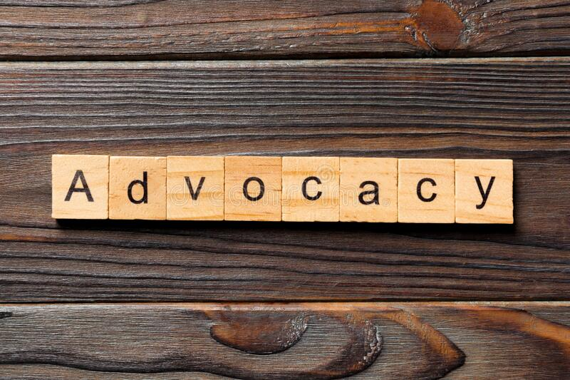 ADVOCACY word written on wood block. ADVOCACY text on wooden table for your desing, concept.  stock images
