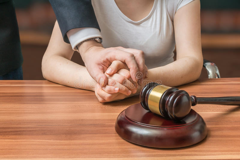 Advocate or lawyer defends accused innocent woman. Legal help and assistance concept royalty free stock photography