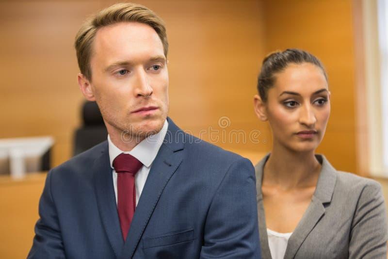 Advogados severos que anticipam imagem de stock
