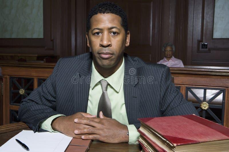 Advokat Sitting In Courtroom arkivfoton