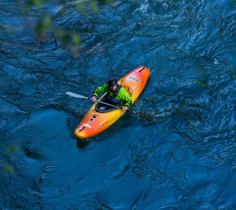 A kayaker goes down on a kayak on a mountain river Belaya in Adygea in the autumn time, the top view royalty free stock photography