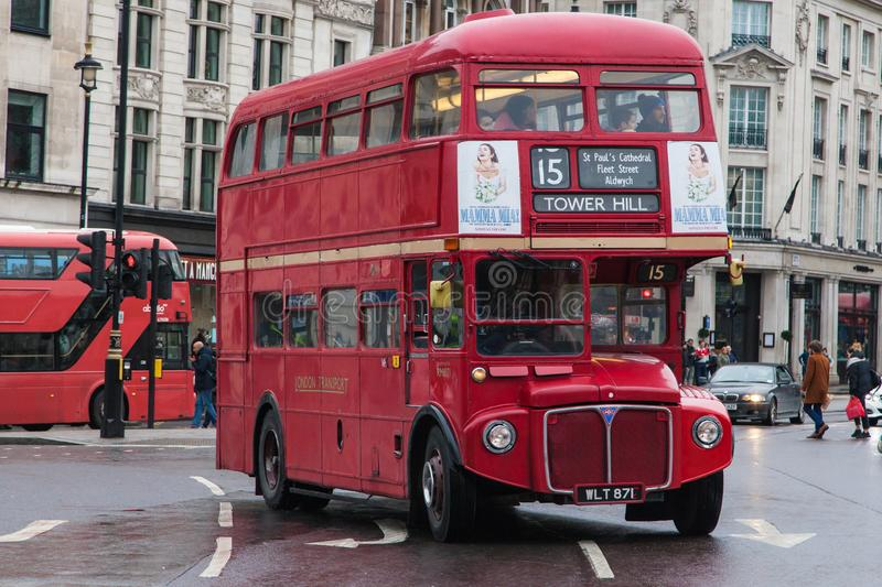 1962 AEC Routemaster at Trafalgar Square. London, United Kingdom - December 23, 2019: 1962 AEC Routemaster Bus travelling around Trafalgar Square heading towards royalty free stock image