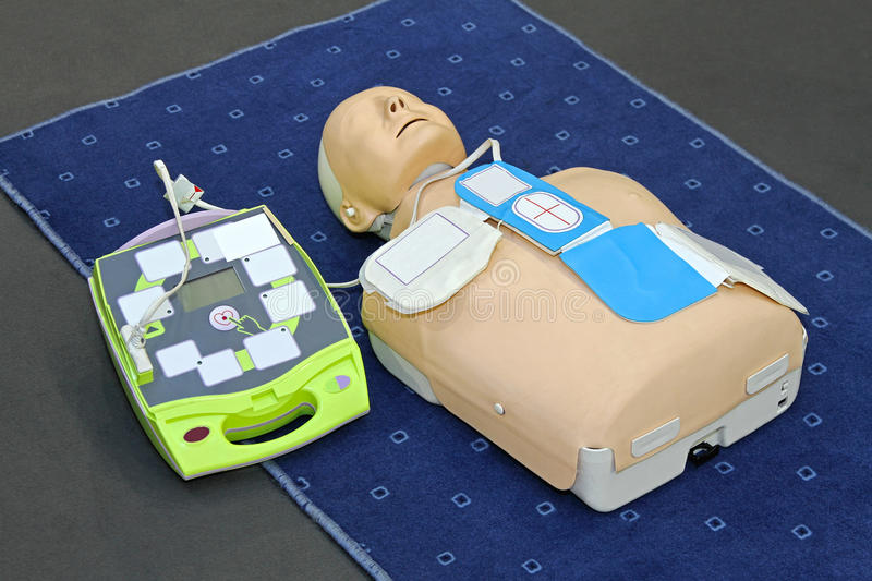 AED dummy. Automated External Defibrillator with training dummy mannequin stock photos