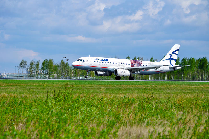 Aegean Airlines Airbus A320 aircraft is riding on the runway after arrival at Pulkovo International airport in Saint-Petersburg stock images