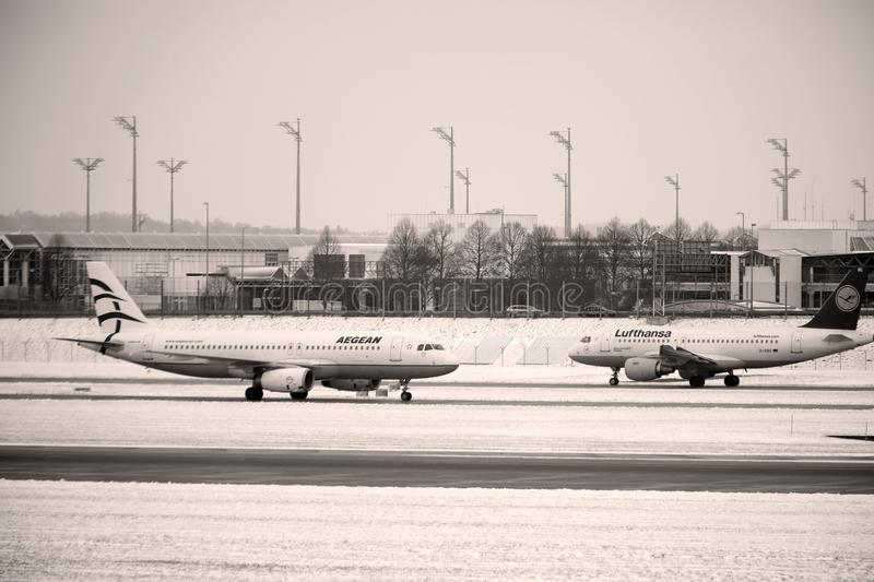 Aegean plane doing taxi in Munich Airport, snow royalty free stock photo